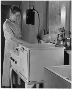 Lillian Gilbreth's design would make kitchens more efficient than this one newly electrified by the REA. Photo from Franklin D. Roosevelt Presidential Library & Museum.